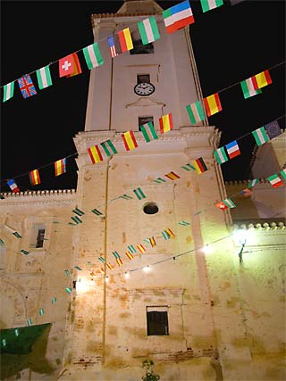 Canar Church Tower at night during the village fiesta